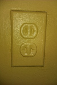 A_power_outlet_painted_over